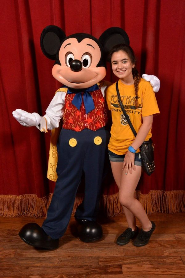 Nayeli Ochoa takes a picture with Mickey Mouse in Disney World
